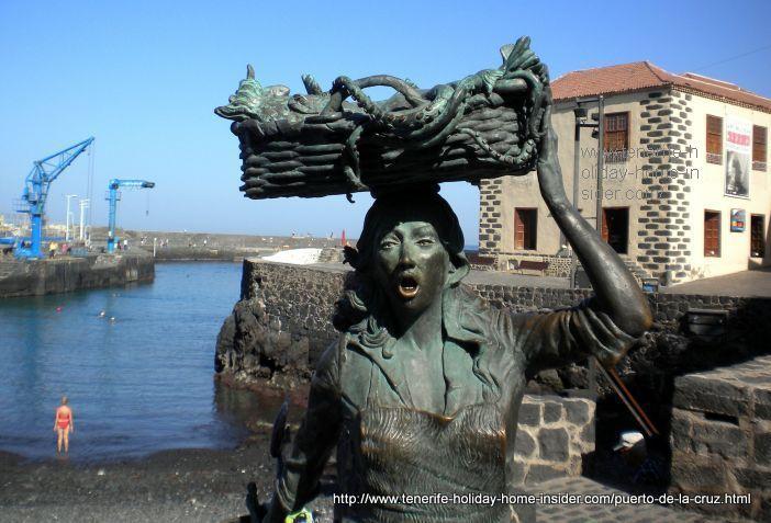 Fish seller sculpture of fish wife at the Puerto Cruz harbor.