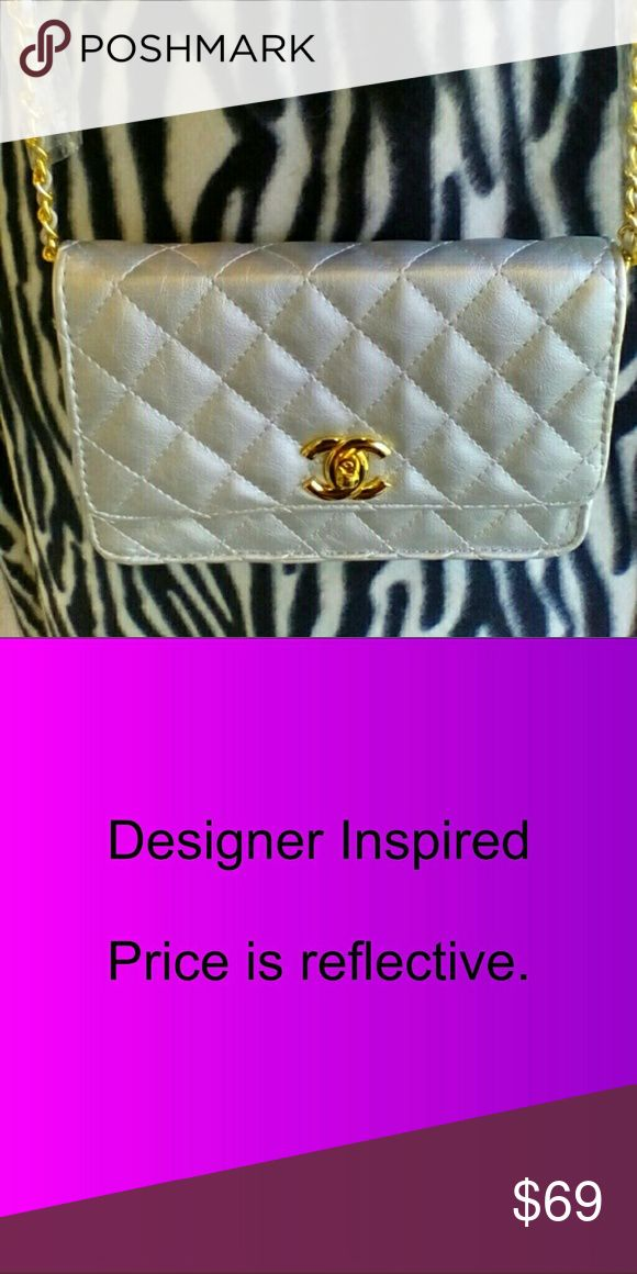 SALE!! New! Silver Fashion Quilted Shoulder Bag Brand new fashion quilted shoulder bag.  Gold hardware, gold chain straps. Measures approx 8x6. Amazing inspirational quality. Price is reflective. Please see ALL pics before purchasing.  Comes with generic dust bag.  Reasonable offers may be considered.  Return customers always appreciated. Thank you for shopping my closet. Bags Shoulder Bags