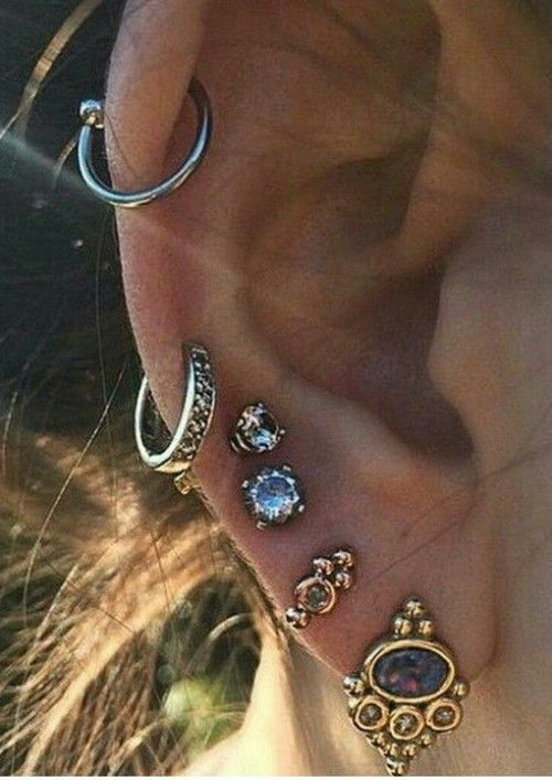Not necessarily all of the piercings but I like the earrings