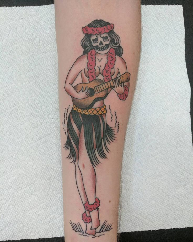 Hula Girl Tattoo by Sue Kidder at Old Iron Sides in Honolulu Hawaii