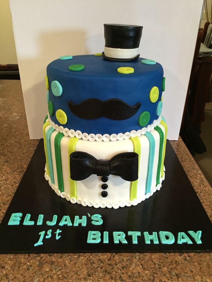 Little Man themed 1st birthday cake. 6 layered chocolate mud cake with white chocolate ganache.