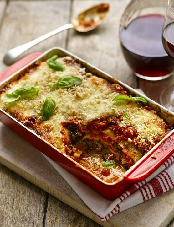 Easy recipe for Aubergine parmigiana. This simple Italian classic of layers of tomato sauce, aubergine and parmesan, is good for family meals or entertaining.