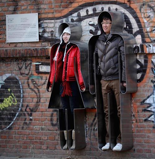 "Lifesize woman & man cookie cutters - ""you and me"" installation in beijing"