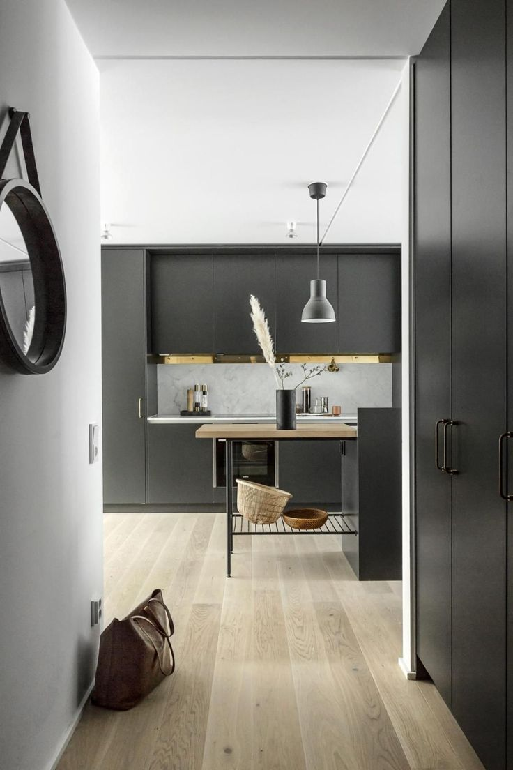 Black kitchen with brass