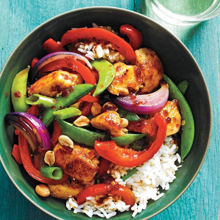 This colorful chicken and veggie stir-fry features a sweet-spicy sauce and a topping of dry-roasted peanuts, which add delicious crunch.