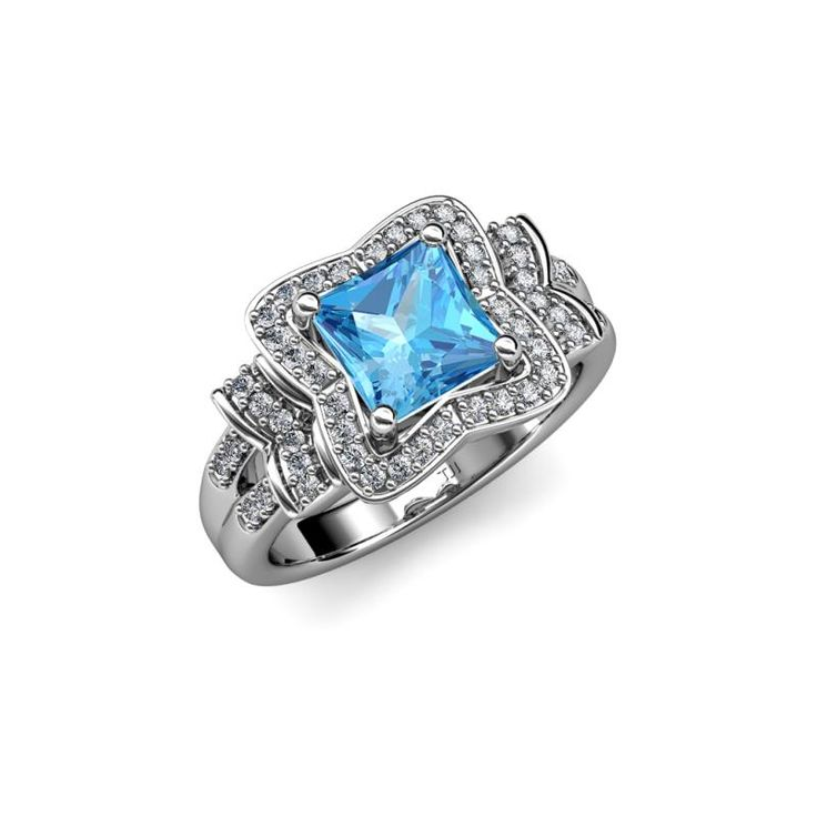 Can't get enough of this #Blue Topaz blue diamond halo engagement ring and wedding band from #Trijewels .com #engagementring #weddingrings #gold #14kgold #womenfashion #haloengagementring #jewelryforwomen #onlinejewellery #DesignerJewellery #Accessories #love #gorgeous #