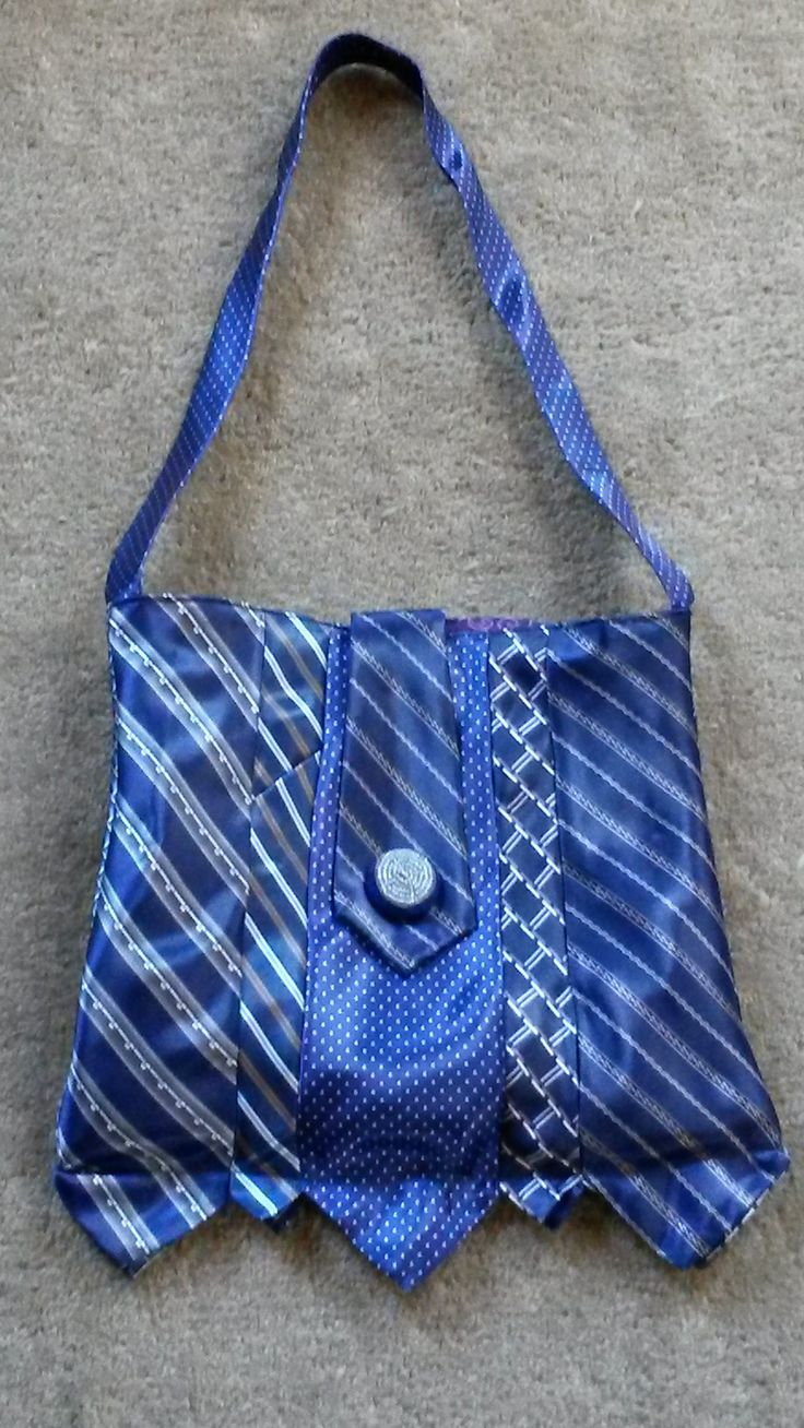 My version of the necktie purse (original at https://www.youtube.com/watch?v=pBCaNNxKi9s ). I made my lining with several pockets (not included in original) Ended up with enough tie pieces left over to make an evening clutch.