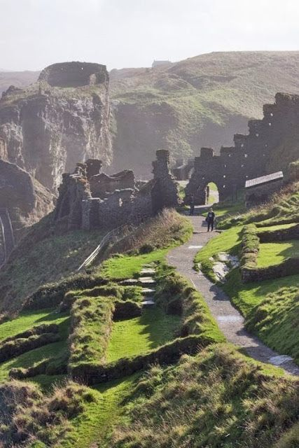The 13th century ruins of Tintagel Castle, overlooking the ocean in Cornwall, England. Excavations demonstrated that this was a fortified home of the ruler of Cornwall in about 500AD. The largest fortified site of the 'Arthurian' period, it contained unprecedented remains of luxury goods from the Eastern Roman Empire. In 1998, a slate engraved with the name 'Artognou' and other names from the legends was discovered there.