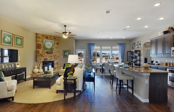 The Stone Fireplace, Wood Floors And Open Kitchen / Living