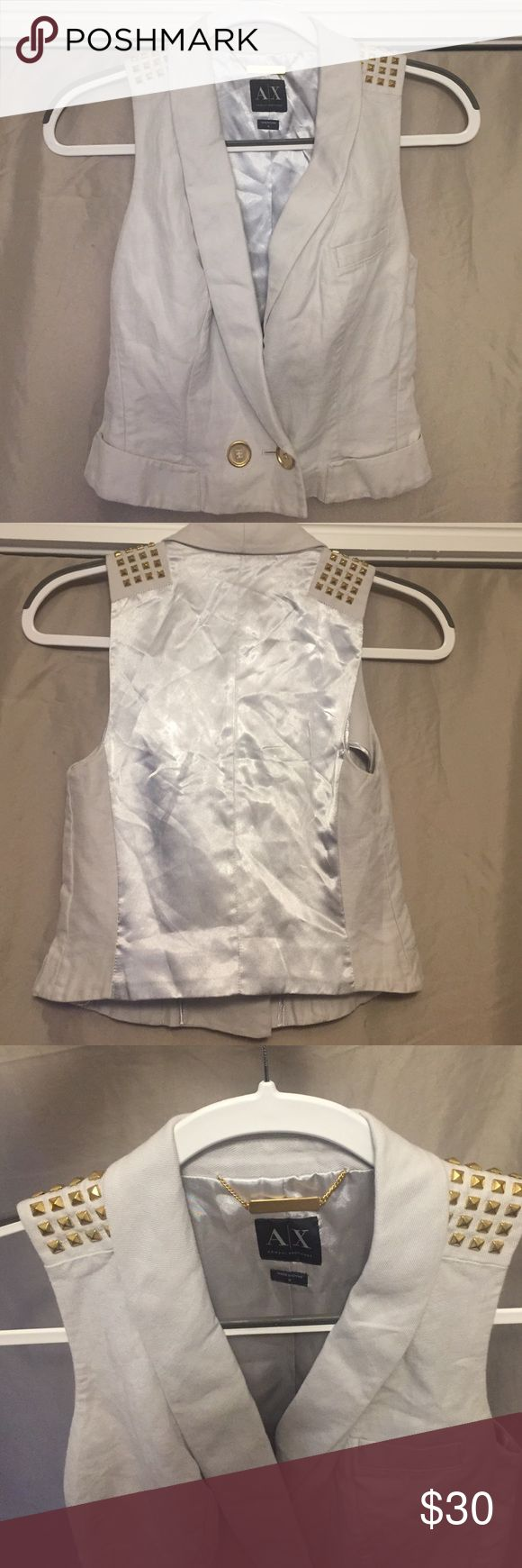 Armani Exchange vest Great condition, hardly worn. Armani Exchange vest in size small. In a slate color (mix of light blue and gray) . Studs on the shoulders and silk back. Shorter style so falls above the hips. You can definitely dress this up or down A/X Armani Exchange Other