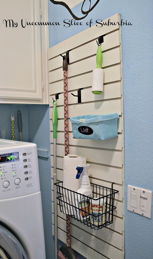 Organized Laundry Room: Love the use of Slatwall--looks nicer than plain pegboard! Also like the clever use of a baby wipes box as a lint trashcan.