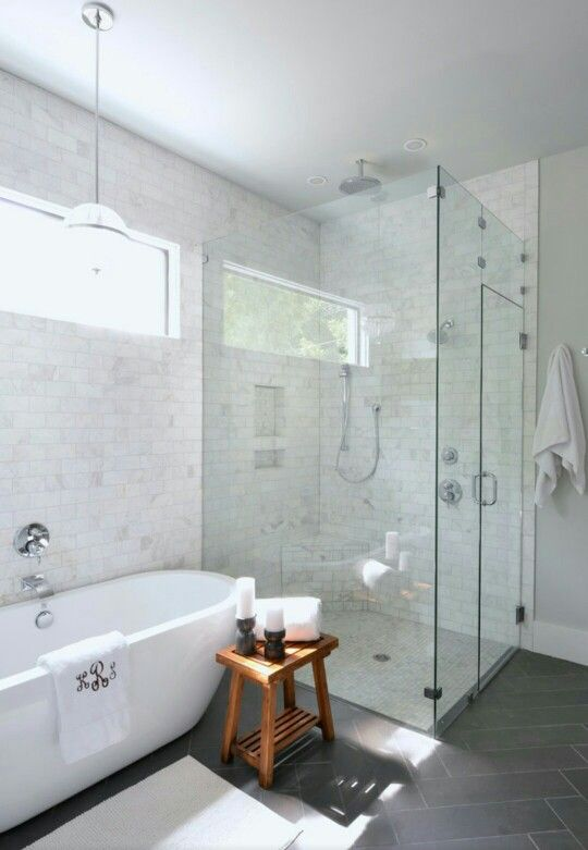Separate tub and glass shower with rain head