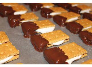 fun sized s'mores. great ideas to have the grahams with the marshmallow served with a chocolate fondue fountain!!