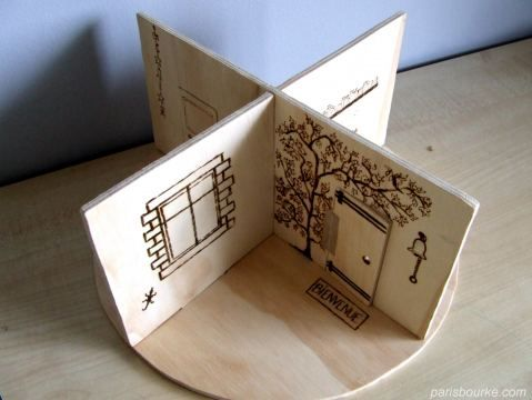 """GENIUS! Interchangeable wooden """"rooms"""" to this mini dollhouse. Decorated with woodburner. Endless possibilities..."""