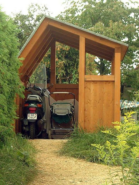 Parking shed behind 2nd bedroom windows for golf cart/gator; bicycles, with a good door with a lock.
