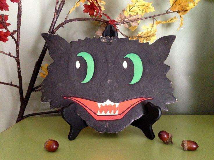 Vintage Halloween Grinning Black Cat Face Luhrs Halloween Embossed Die Cut 1950s Halloween Display Decor Collectible by santashauntedboot on Etsy https://www.etsy.com/listing/108957674/vintage-halloween-grinning-black-cat