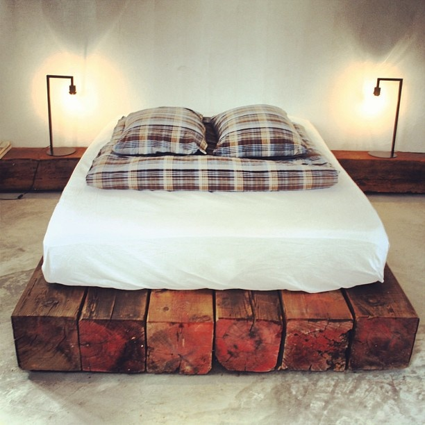 Reclaimed wooden beams used for a simple   style bed