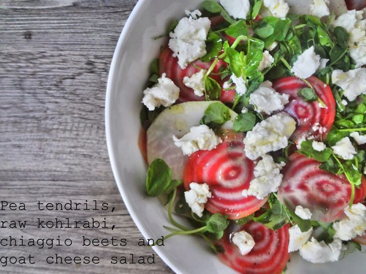 Pea tendrils, raw kohlrabi, chioggia beets and goat cheese salad