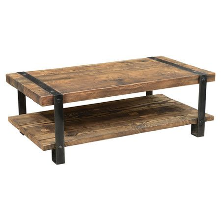 With a look inspired by timeworn bourbon casks, this wood and iron coffee table brings rustic appeal to any space. Product: Co...