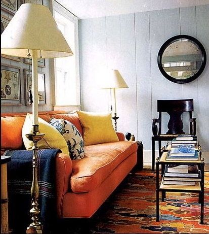 Orange Sofa Blue Accents Light Grey Walls Contemporary Color Palette In A Traditional
