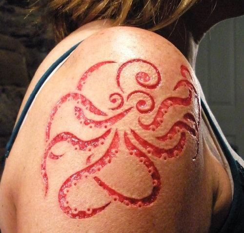 Octopus scarification. Cthulhu is pleased......scaring actually creeps me out but this is done clean and beautiful