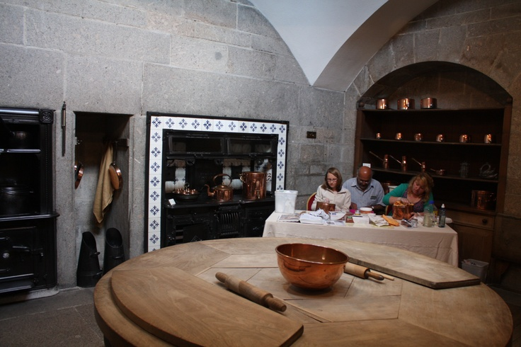One of Edwin Lutyens best known interiors, the kitchen at Castle Drogo in Devon is a masterpiece in spatial design.  The round table is one of his best known pieces. In a real tour de force of imagination Lutyens echoes the stunning oriel window above with the round table below
