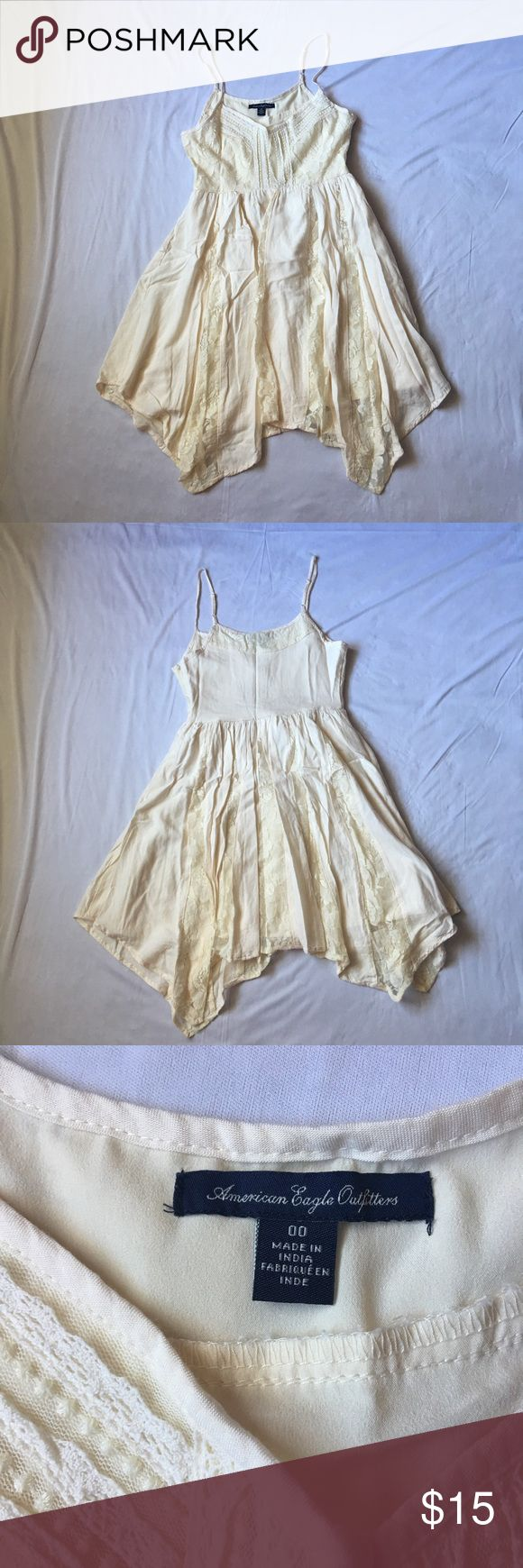 Cream American Eagle Dress This is a beautiful cream American Eagle Dress in near perfect condition. Only worn twice. The only flaw is right above the hook closure there is blue discoloration from wearing a jean jacket. The spots are very tiny and aren't noticeable when worn since it is under the arm. Any questions just ask! First photo is stock photo. American Eagle Outfitters Dresses