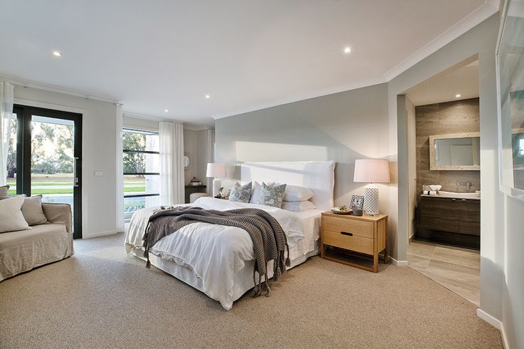 Spacious master bedroom with a balcony in Caribbean World of Style on display in the Charlton 33.