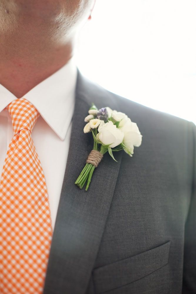 I really like this whole combination...kinda want to steal it. Grey suit, orange tie and simple but elegant boutonniere. perfect.