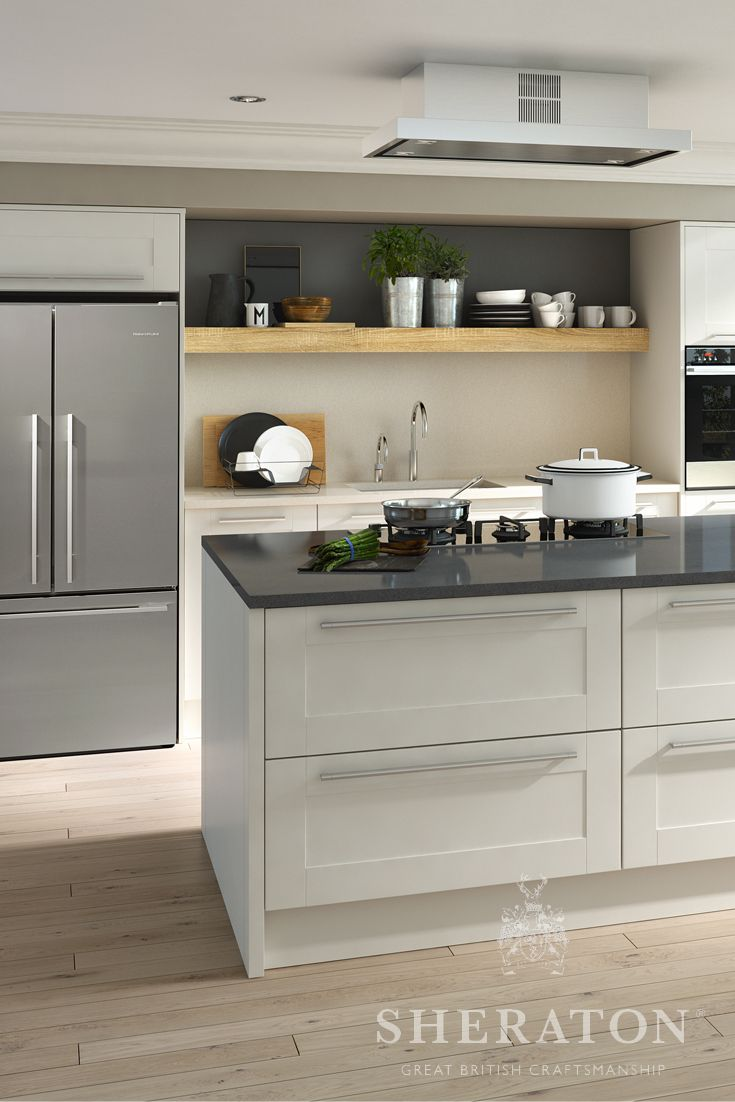 Contemporary kitchen in Ivory.  This simple layout includes a large island design with integrated dining table and benches.  For more information please see http://www.sheratonkitchens.co.uk/kitchens/broad-style-ivory
