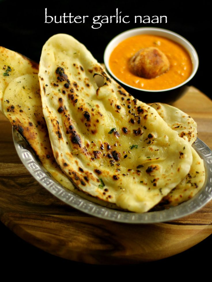 garlic naan recipe, garlic butter naan recipe on tawa & stove top with step by step photo and video recipe without yeast. naan bread is a north indian bread