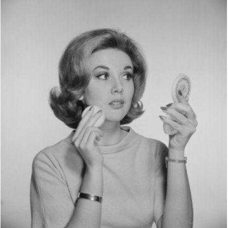Studio portrait of woman applying make-up Canvas Art - (24 x 36)