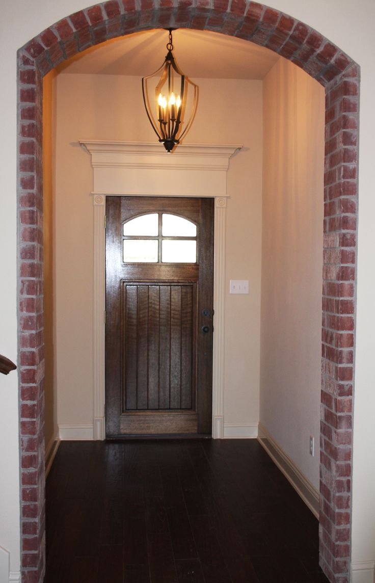 Clarity Homes. Better Things. Exposed Brick Archway.