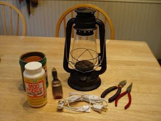 "Turn an oil lantern to a ""rusty,"" electric, primitive lantern."
