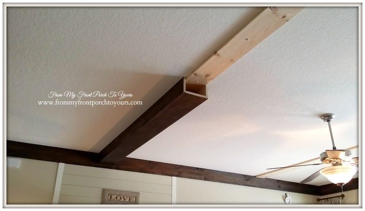 How To: DIY Wood Beams - 1x8 (wall border, bottom of beams and ceiling brad) and 1x6 (sides of beams) and scraps (straps for both ends of beams and where wood meets in ceiling) -- stain, screws, nail gun, toggle bolts