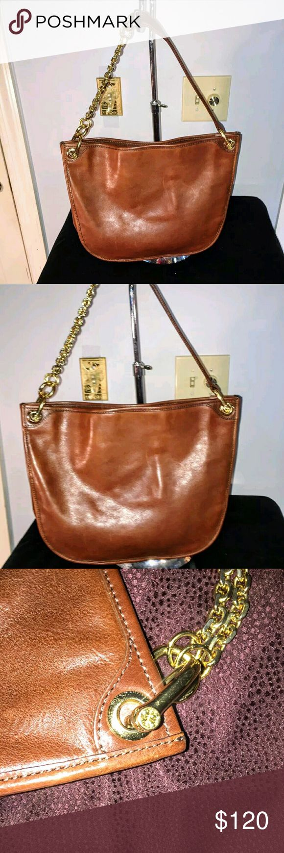 """$348 Tory Burch Cognac Leather Chain Shoulder Bag Pre-owned bag in very good condition. Light, normal  signs of wear on exterior but very minimal and corners/edges are in good shape! Thick gold chain strap adds a littke pizazz and us very sturdy. The interior is suede with a zip & open pocket. Notice slight discoloration by interior pocket...no idea.....as my sister stated ZERO stains etc. Not seen from outside, not major & may rub out. 10.5""""H x 13""""L x 3"""". **PRICED LOW FOR QUICK SALE** Tory…"""
