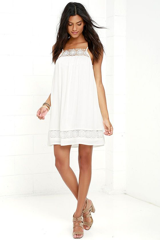 The Western Winds White Lace Shift Dress is so cute, it might just blow you away! Crocheted lace trims the neckline and hem of this breezy, woven shift dress. Adjustable straps. Scoop back.