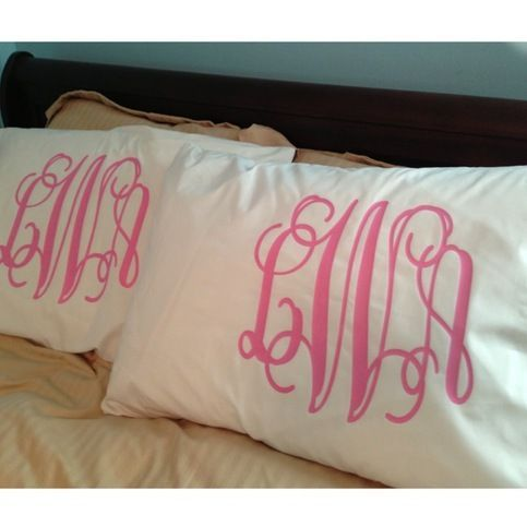 Monogrammed pillowcases good way to tie a color scheme into plain pillowcases