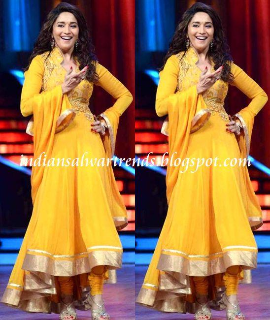 Latest Salwar and Designer Dresses: Madhuri dixit in plain yellow color anarkali