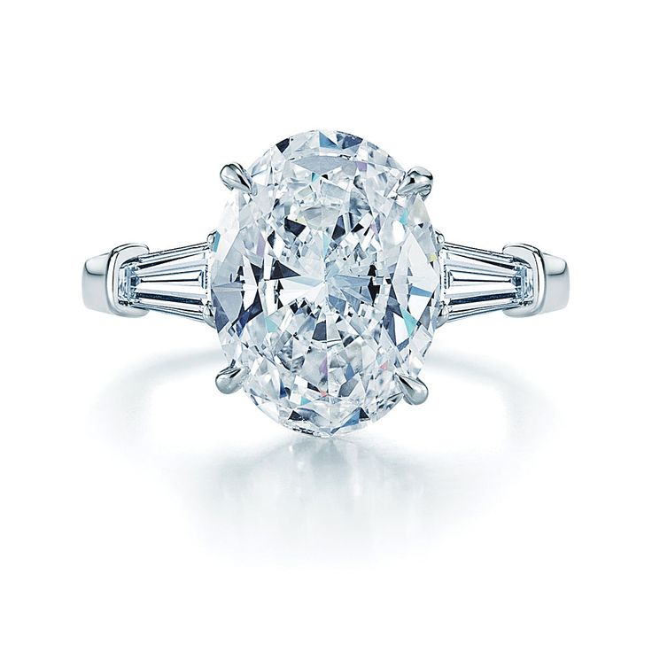Oval Diamond and Platinum Ring with Two Tapered Baguettes