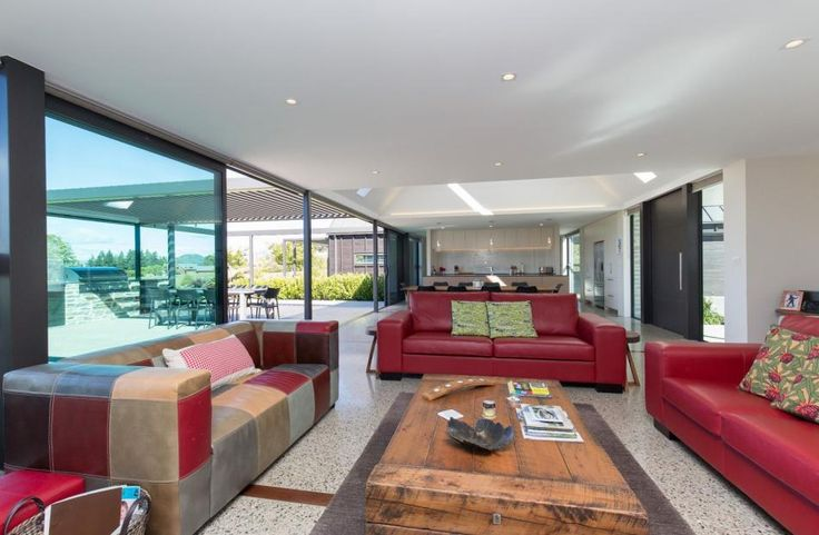 The open-plan kitchen-dining-living area opens out to the barbecue area and lawn. The practical...