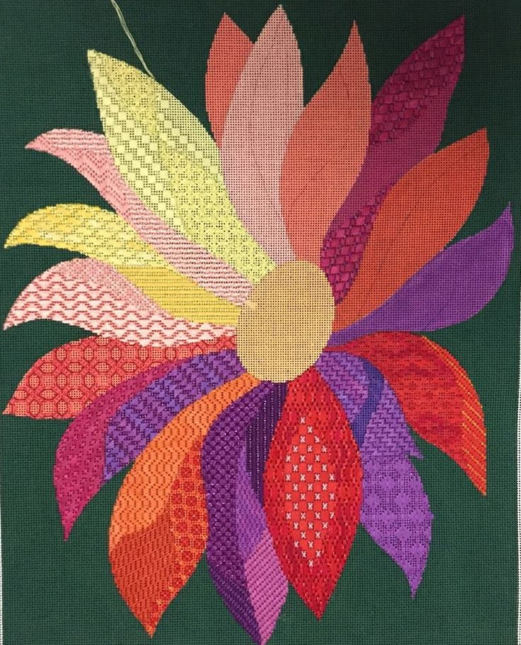 needlepoint flower with lots of stitches