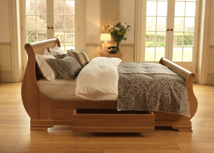 Almost organic in its natural beauty, the Camargue sleigh bed has been lovingly crafted and hand-set into position to achieve those quintessential fluid lines. Taking its inspiration from the majestic Camargue region of France, this handmade sleigh bed is built from the finest 150-200 years old solid oak. Every aspect, from the carved scrolling to the brass detailing, has been painstakingly crafted by hand to add an air of classically French chic styling to your bedroom. #bedswithstorage