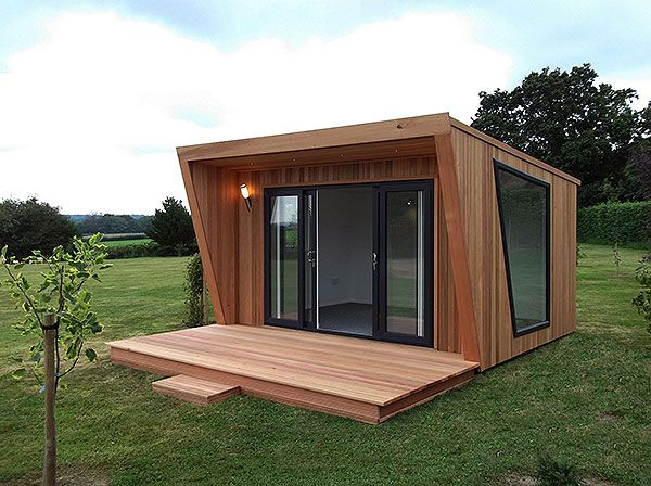 Pinnacle 4x3m garden office, clad in cedar with sliding door and window combination in graphite grey, feature picture window and extra decking, from £12,995 (inc. VAT).