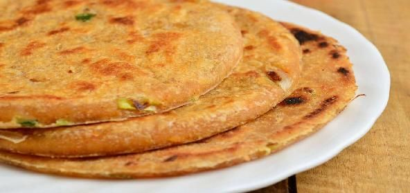Tangy Paneer Parathas for an Indian Breakfast. Made of wheat flour and cottage cheese, a healthy combination of carbs and protein. Goes well with some tangy mango pickle and chilled, thick yogurt.