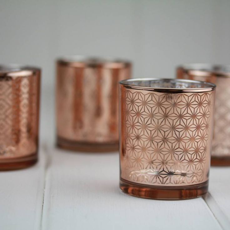 I've just found Set Of Four Copper Tealight Holders. Stunning copper tealight holders. Designed with geometric patterns in mirrored copper glass. They look beautiful before the tealights have even been lit!. £16.00