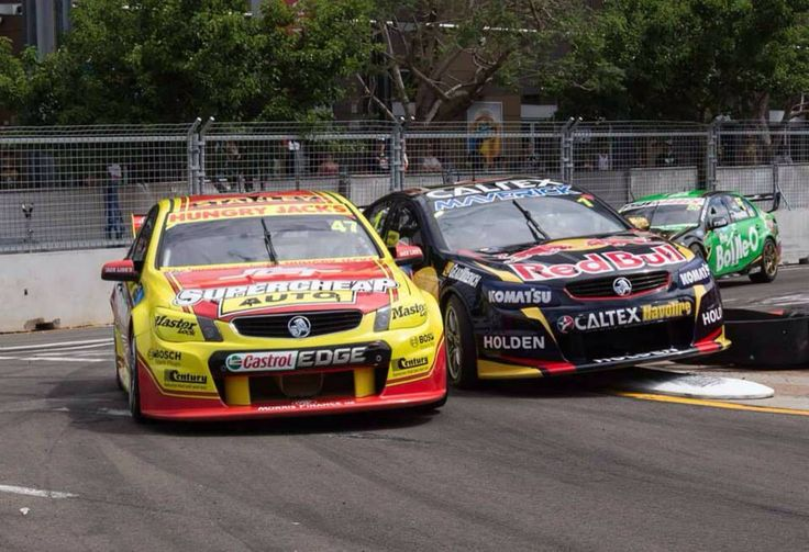 Tim Slade #47 and Jamie Whincup #1 having a tight squeeze