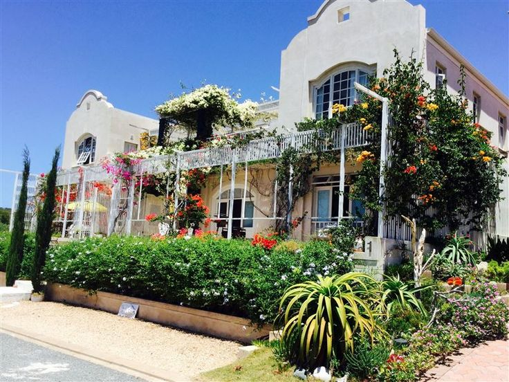 Charlotte House - Charlotte House is a Dutch-Mediterranean home offering four self-catering apartments and meals on request.   We overlook the bay and are situated alongside a coastal nature reserve, with pathways leading ... #weekendgetaways #stilbaai #southafrica