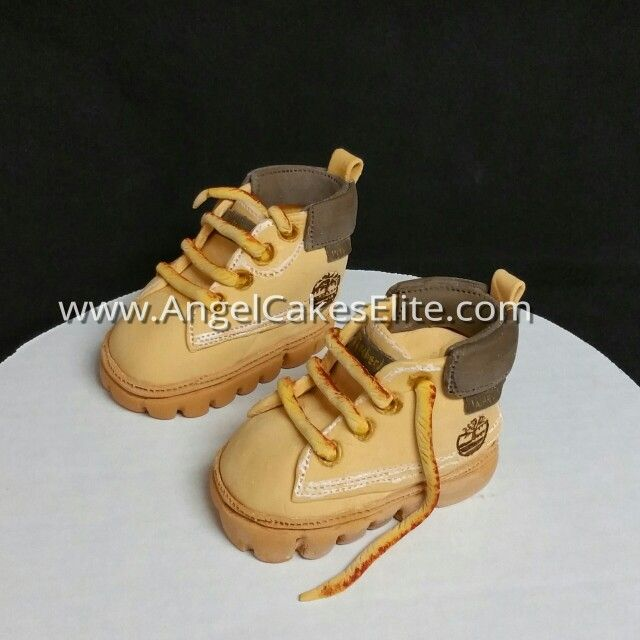 Edible timberland baby boots. Made with rice cereal, fondant and modeling chocolate.