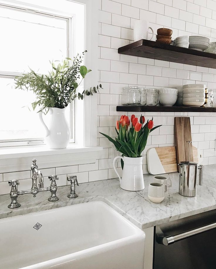 white kitchen + floating wood shelves